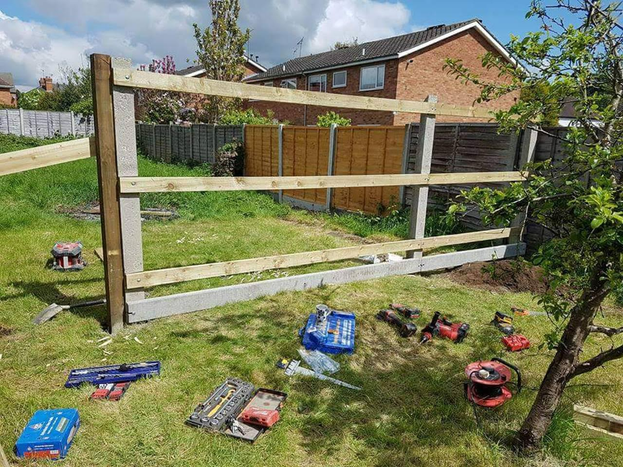 This Is A Fence In Mid Construction Using A Recessed Post And Concrete Gravel Board